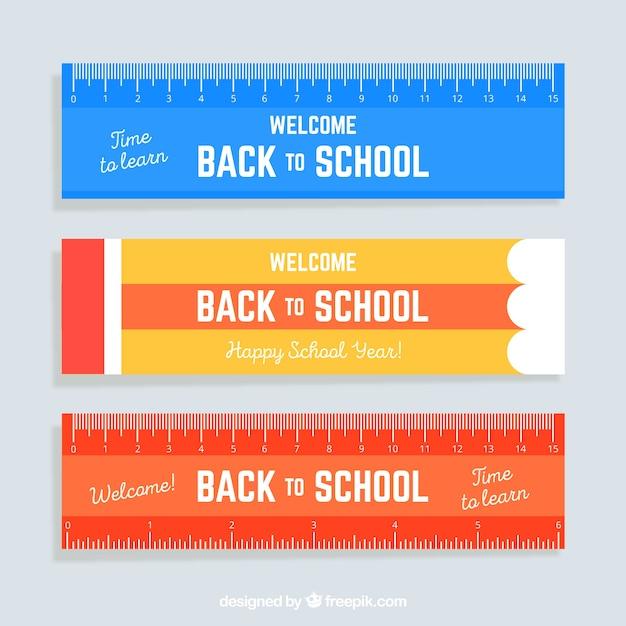 Tre di nuovo agli insegne di scuola nello stile del righello Vettore Premium