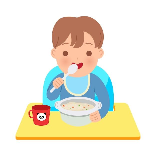 Ragazzo del bambino che si siede sulla sedia del bambino che mangia una ciotola di porridge. illustrazione genitoriale felice. giornata mondiale dei bambini. in sfondo bianco. Vettore Premium