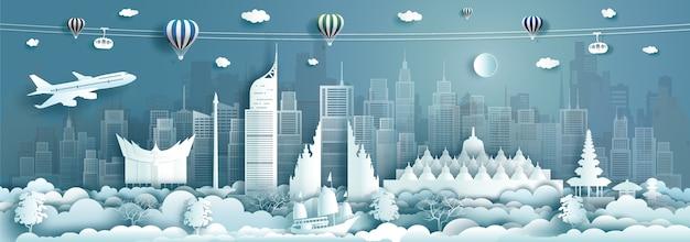 Architettura di viaggio monumenti di indonesia nella famosa città di giacarta dell'asia su sfondo blu con aria calda di palloncini. visita la malesia con la capitale popolare panoramica con origami di carta Vettore Premium