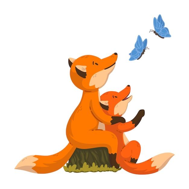 Due volpi stanno guardando le farfalle. genitore di animali della foresta del fumetto con il bambino. Vettore Premium