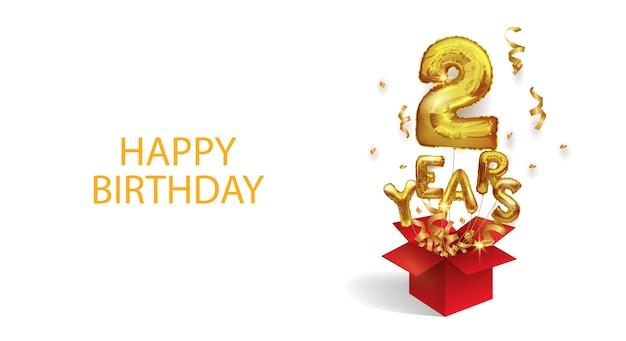Due anni dalla nascita. numero 2 un palloncino di foil volante vola fuori da una scatola di coriandoli. festa di compleanno. Vettore Premium