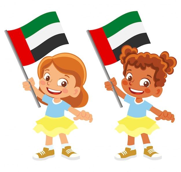 Insieme della bandiera degli emirati arabi uniti in mano Vettore Premium
