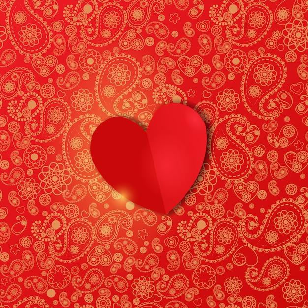 Sfondo di san valentino con cuore di carta su un bellissimo motivo paisley rosso. Vettore Premium