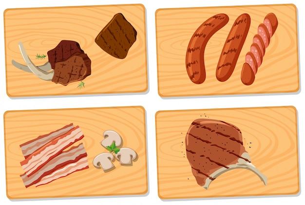 Varietà di carne su taglieri Vettore Premium