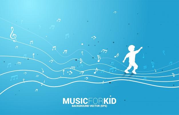 Vector la siluetta del bambino che funziona con la nota di musica di forma di flusso di dancing. musica per bambini e ragazzi. Vettore Premium
