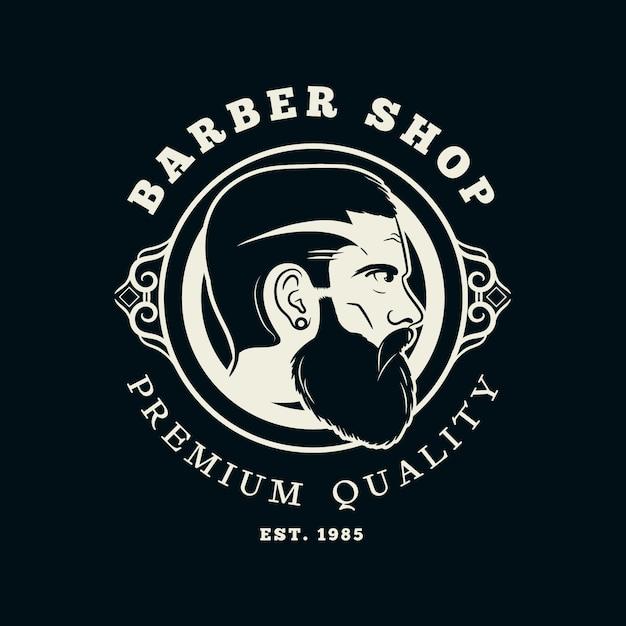 Logo del negozio di barbiere vintage Vettore Premium
