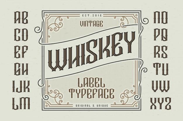 Carattere tipografico vintage con etichetta decorativa Vettore Premium