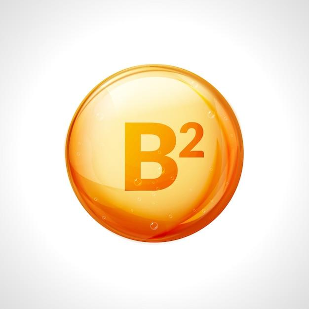 Essenza d'oro di vitamina b2. trattamento vitaminico con pillola a goccia di riboflavina. medicina naturale dorata isolata. Vettore Premium
