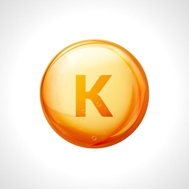 Vitamina k arancione cura dietetica lucida. simbolo organico sano vitamina k cibo dietetico. Vettore Premium