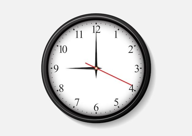 Orologio da parete che mostra le nove. Vettore Premium