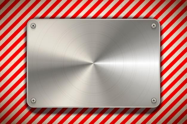 Strisce rosse e bianche del segnale di pericolo con il piatto in bianco del metallo lucidato, fondo industriale Vettore Premium
