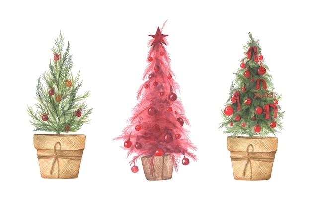 Insieme dell'illustrazione dell'acquerello di alberi di natale in vaso. Vettore Premium