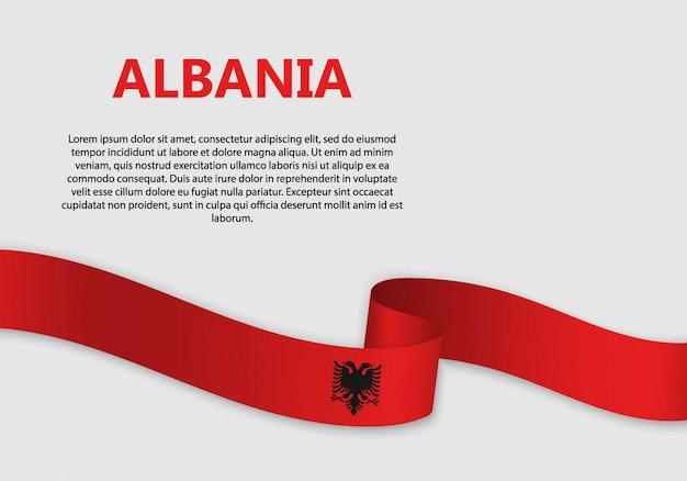 Bandiera sventolante bandiera dell'albania Vettore Premium