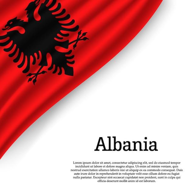 Sventolando la bandiera dell'albania su bianco Vettore Premium