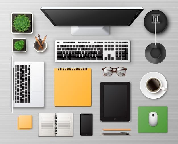 Tavolo da lavoro in legno bianco con materiale per ufficio e dispositivi digitali Vettore Premium