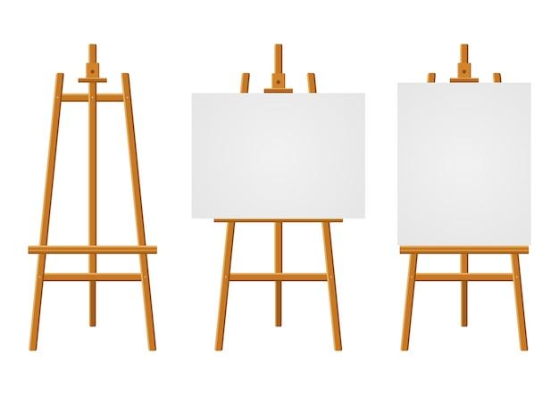 Cavalletti in legno o tavole da pittura con tele bianche di diverse dimensioni. cavalletti con fogli di carta. Vettore Premium