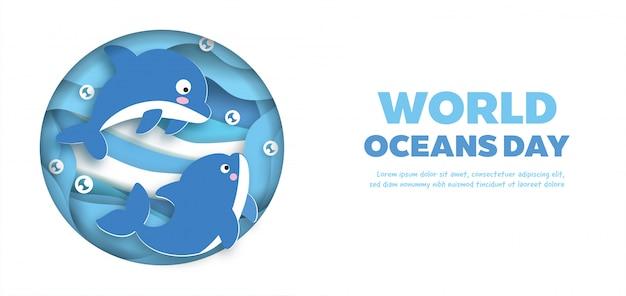 Banner di giornata mondiale degli oceani con simpatico delfino in stile taglio carta. Vettore Premium