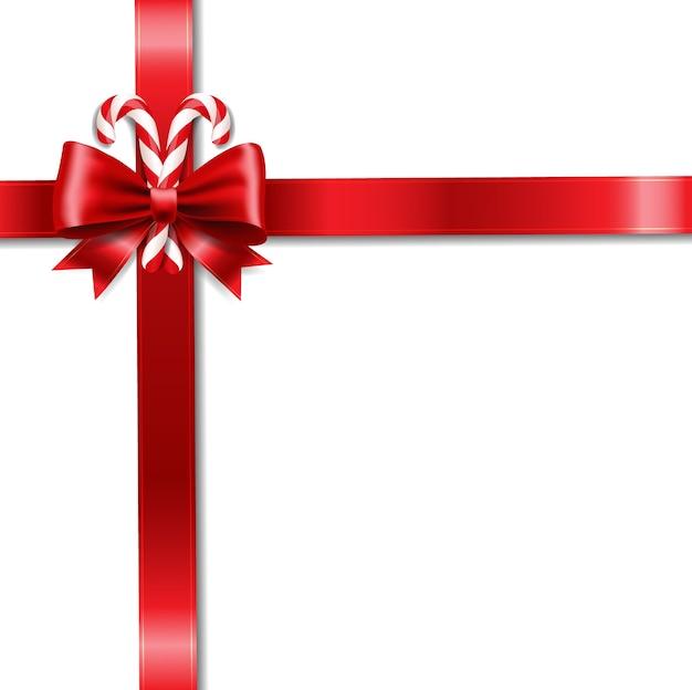 Fiocco di nastro di natale e sfondo bianco lecca-lecca Vettore Premium