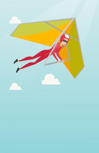 Giovane donna caucasica volando in deltaplano Vettore Premium