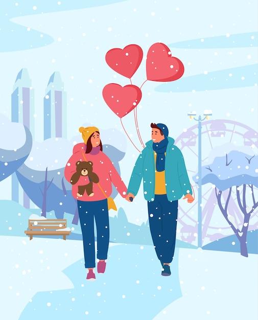 Giovane coppia mano nella mano con palloncini a forma di cuore a piedi in winter park Vettore Premium