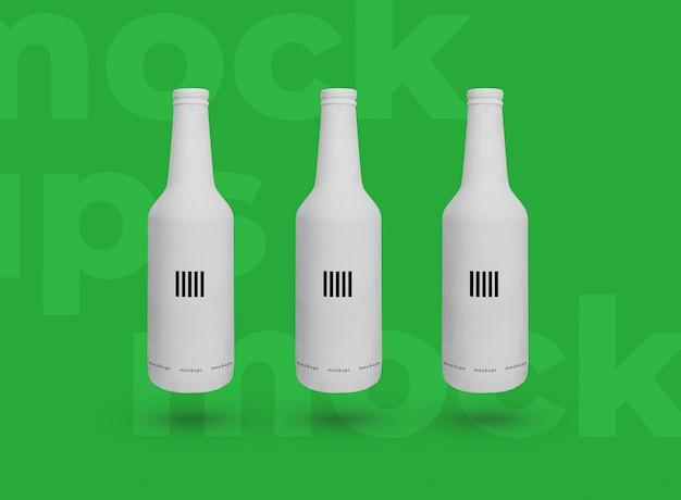 3 mockup di bottiglie di birra bianca Psd Premium