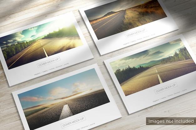 4 landschapstijdschriften met zachte kaft op houten bureau mockup Premium Psd