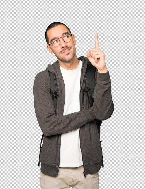 Aarzelende student die met zijn vinger omhoog wijst Premium Psd