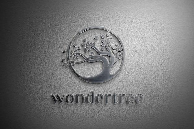 Aluminium logo mockup op een witte muur textuur Premium Psd