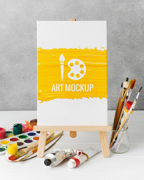 Arrangement met aquarellen en canvas Gratis Psd