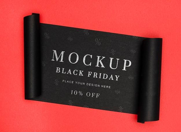 Banner enrollado de maqueta de ventas de viernes negro de fondo rojo PSD gratuito