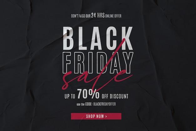 Banner de venta de viernes negro en fondo de papel encolado PSD gratuito