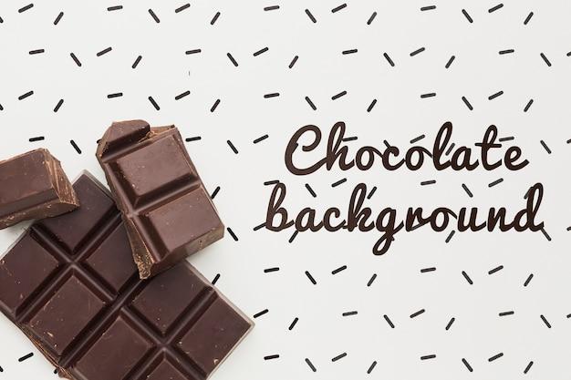 Barra di cioccolato deliziosa con il modello bianco del fondo Psd Gratuite