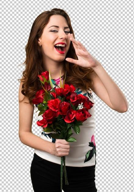Bei fiori e gridare della tenuta della ragazza Psd Premium