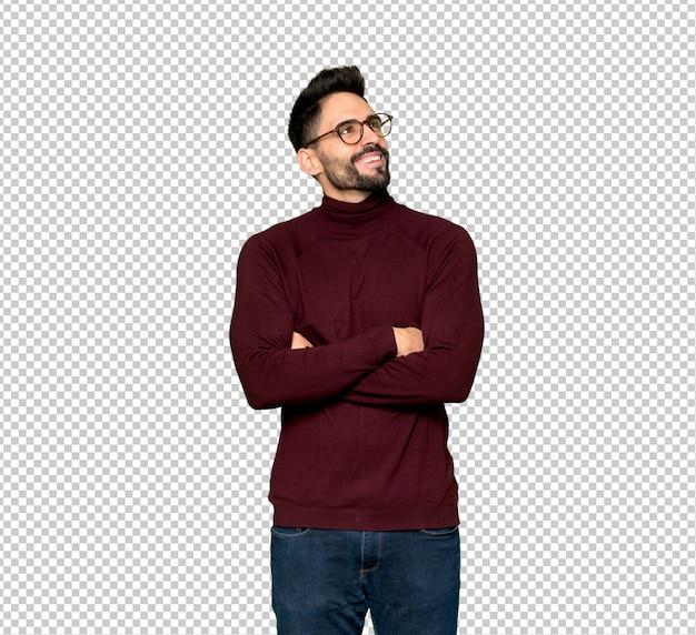 Bell'uomo con gli occhiali guardando mentre sorridente Psd Premium