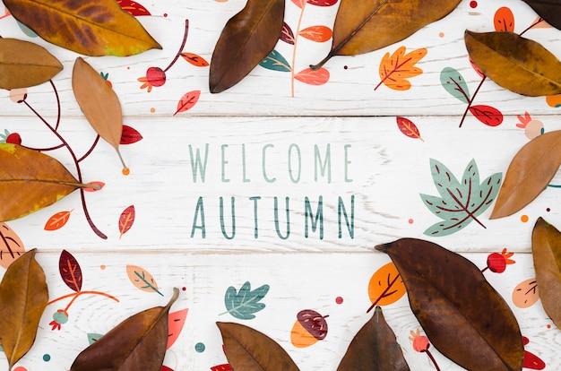 Benvenuto concetto autunnale circondato da foglie marroni Psd Gratuite