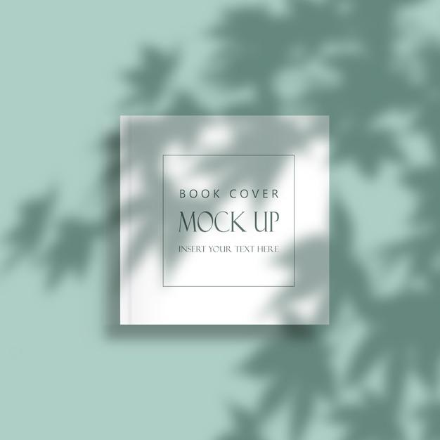 Bewerkbare minimale cover van het boek mock-up met schaduw overlay bladeren Gratis Psd