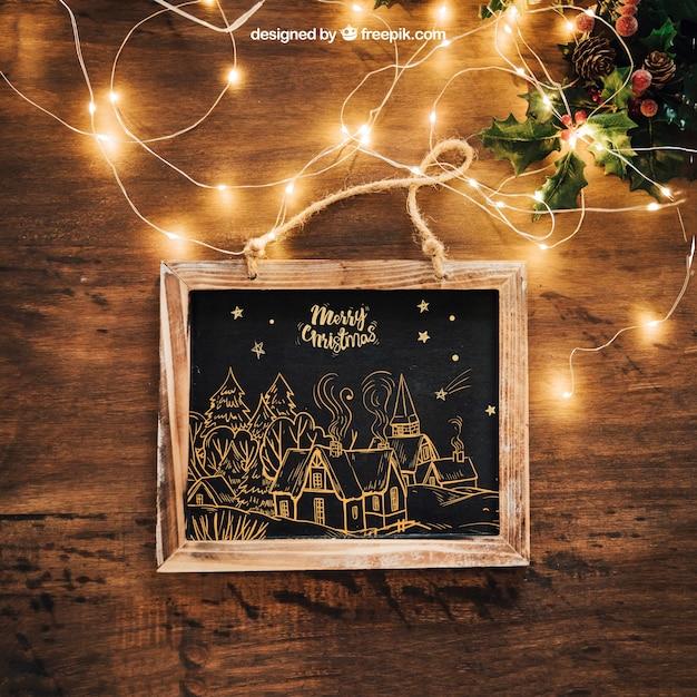 Blackboard en verlichting mockup met christmtas ontwerp Gratis Psd