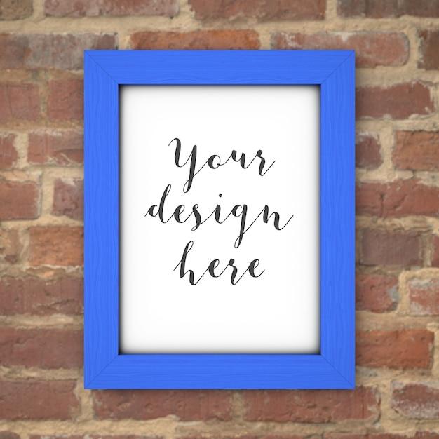 Blauw frame mockup op bakstenen muur Gratis Psd