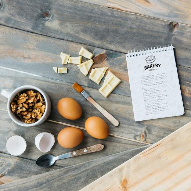 Blocnotemodel met keuken en receptenconcept Gratis Psd