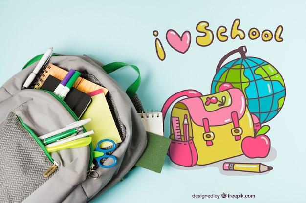 Bovenaanzicht arrangement met schooltas Gratis Psd