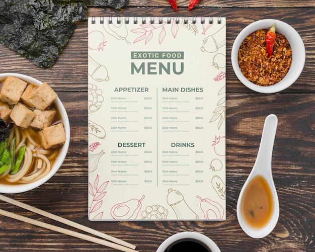 Bovenaanzicht exotisch eten menu met mock-up Gratis Psd