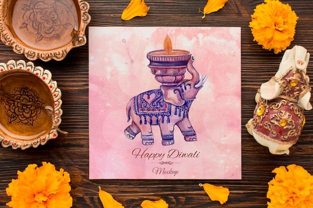 Bovenaanzicht gelukkige diwali festival mock-up olifant en bloemen Gratis Psd