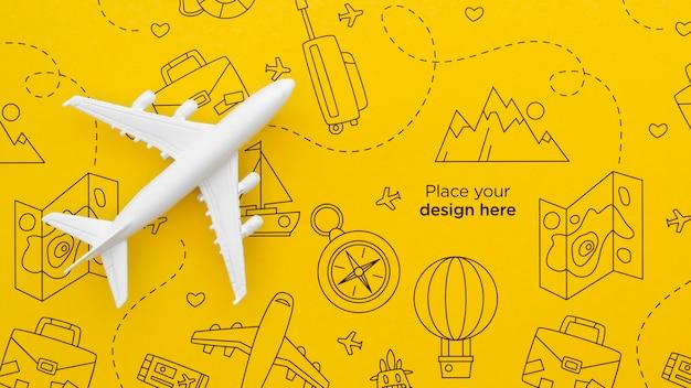 Bovenaanzicht reizende vliegtuig met doodles Premium Psd