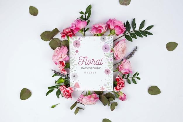 Bovenaanzicht roze rozen en bladeren frame mockup Premium Psd