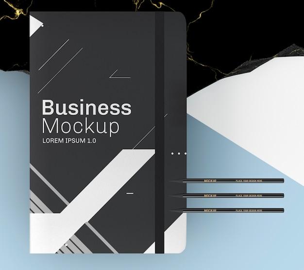 Bovenaanzicht simplistisch zwart notitieboekje Gratis Psd