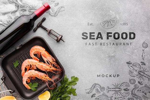 Bovenaanzicht smakelijke zee eten regeling met mock-up Gratis Psd