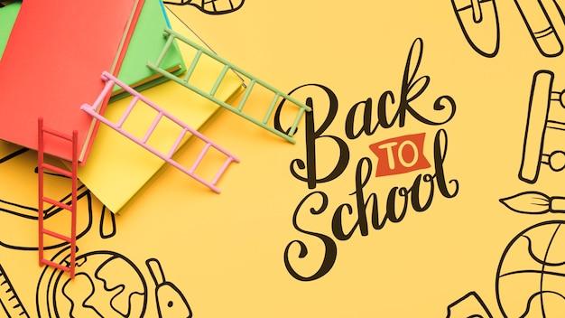 Bovenaanzicht terug naar school met gele achtergrond Gratis Psd