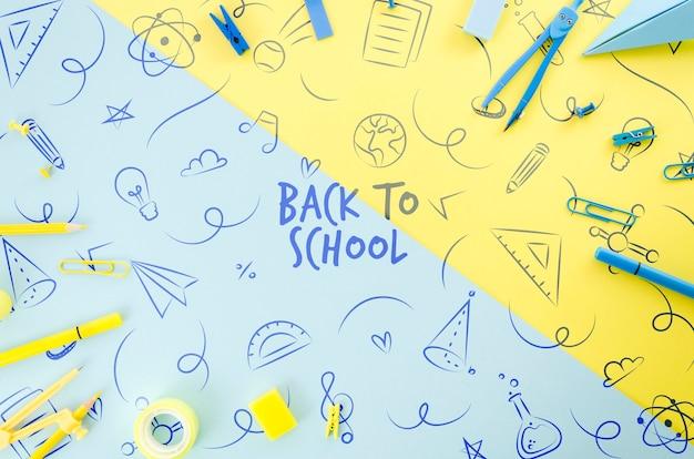 Bovenaanzicht terug naar school met kleurrijke achtergrond Gratis Psd