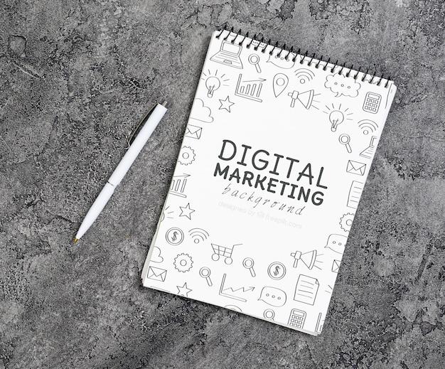 Bovenaanzicht van digitale marketing notebook Gratis Psd