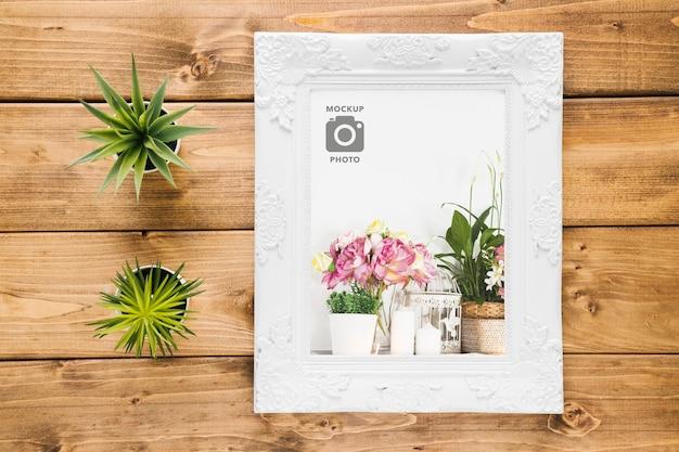 Bovenaanzicht van frame met vetplanten Gratis Psd